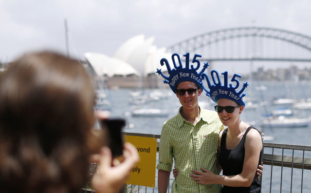 Christoph Kohler (L) and Carola Kohler from Freiburg, Germany, wear novelty hats as they prepare to usher in 2015 in Sydney December 31, 2014. (Photo by Jason Reed/Reuters)