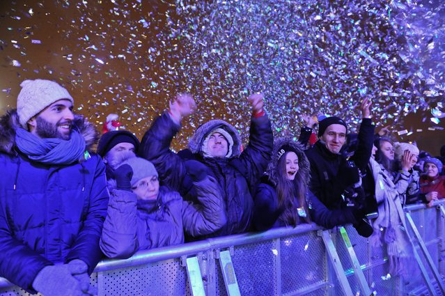 Thousands of people gather to see the fireworks display and celebrate the New Year in Warsaw, Poland, 01 January 2015. (Photo by Marcin Obara/EPA)