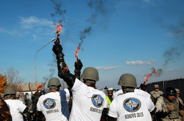 KFOR manoeuvre units conduct a Crowd and Riot Control (CRC) exercise at camp Vrello in Slatina near Pristina Airport, November 20, 2015. The purpose of this exercise was to enhance NATO Forces in Kosovo capability in order to maintain the readiness of troops and increase the operational flexibility. (Photo by Hazir Reka/Reuters)