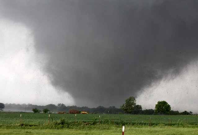 A monstrous, half-mile wide tornado with winds as high as 200 mph passes across south Oklahoma City on Monday. The tornado roared through the Oklahoma City suburbs, killing at least 51 people (including at least 20 children), flattening entire neighborhoods, setting buildings on fire and landing a direct blow on an elementary school. (Photo by Paul Hellstern/The Oklahoman)