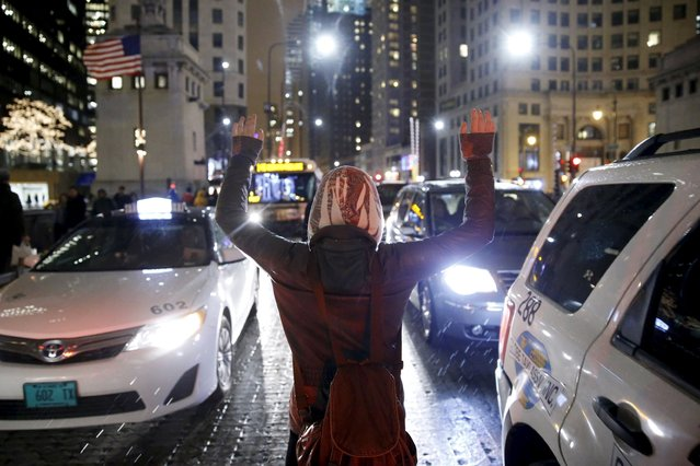 A protester demonstrates in response to the fatal shooting of Laquan McDonald in Chicago, Illinois, November 25, 2015. (Photo by Andrew Nelles/Reuters)
