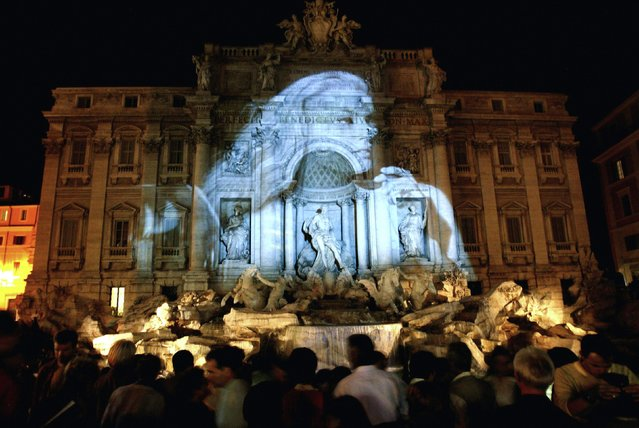 "An image of Swedish actress Anita Ekberg, protagonist of Federico Fellini's movie ""La Dolce Vita"", is projected onto the Trevi Fountain, where one of the film's most notorious scenes was shot, during the ""White Night"" festivities in Rome in this file photo taken September 27, 2003. (Photo by Max Rossi/Reuters)"