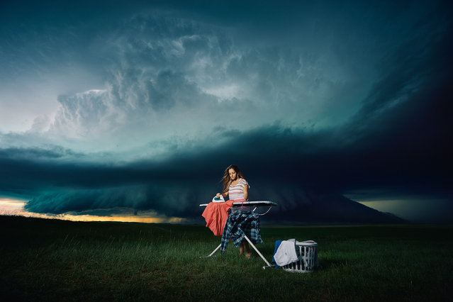 Models pose in front of a storm in Boyes, Montana. (Photo by Benjamin Von Wongs/Caters News)