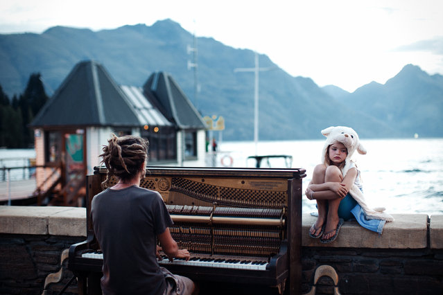 """Merit Winner: """"Piano play at sunset"""". Streets of Queenstown, New Zealand at the end of one more day filled with adrenaline. Calming and doleful scene with piano sound in the background. (Photo and caption by Nikola Smernic/National Geographic Traveler Photo Contest)"""