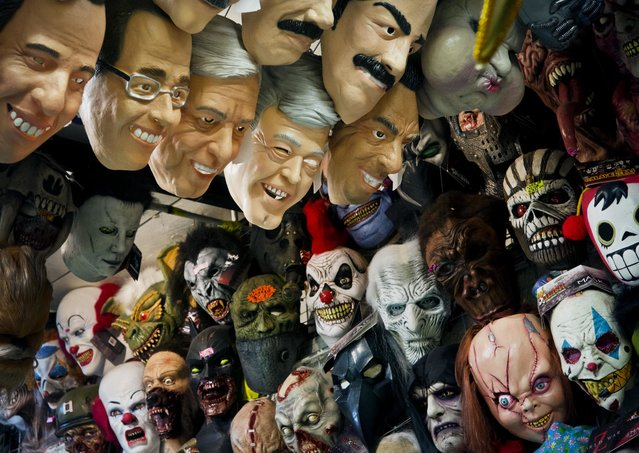 From left to right: masks representing Mexican presidential candidates Jose Antonio Meade, of the Institutional Revolutionary Party (PRI), Ricardo Anaya, center, of the left-right coalition Forward for Mexico, and Andres Manuel Lopez Obrador of the Morena party are for sale at a local market in Mexico City, Monday, June 25, 2018. Mexico's four presidential candidates are holding their last weekend of campaigning before the country's July 1 elections. (Photo by Ramon Espinosa/AP Photo)