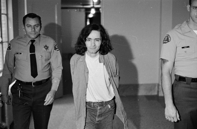 Charles Manson is clean-shaven for the second time since his arrest, as he walks to the room where he listens to proceedings in his trial on murder charges in the Sharon Tate slayings, October 21, 1970.  Manson and three women defendants in the case have been banished from the courtroom because of their misbehavior. (Photo by George Brich/AP Photo)