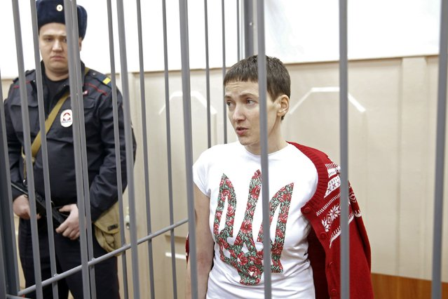 Ukrainian army pilot Nadezhda (Nadia) Savchenko looks out from a defendant's cage during a hearing at the Basmanny district court in Moscow February 10, 2015. Savchenko is accused in Russia of providing coordinates for a mortar attack in east Ukraine in which two Russian journalists were killed last summer. (Photo by Maxim Zmeyev/Reuters)