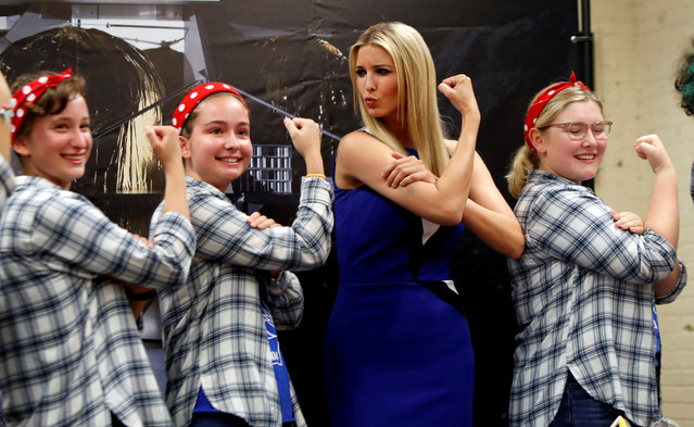 Ivanka Trump poses with Kristina Hilko, Lauren Shovlin, and Anna Nesbitt, members of the Girls of Steel Robotics initiative, at the Astrobotic Technology facility in Pittsburgh, Pennsylvania on August 14, 2018. (Photo by Jason Cohn/Reuters)