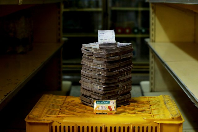 A bar of soap is pictured next to 3,500,000 bolivars, its price and the equivalent of 0.53 USD, at a mini-market in Caracas, Venezuela August 16, 2018. It was the going price at an informal market in the low-income neighborhood of Catia. (Photo by Carlos Garcia Rawlins/Reuters)