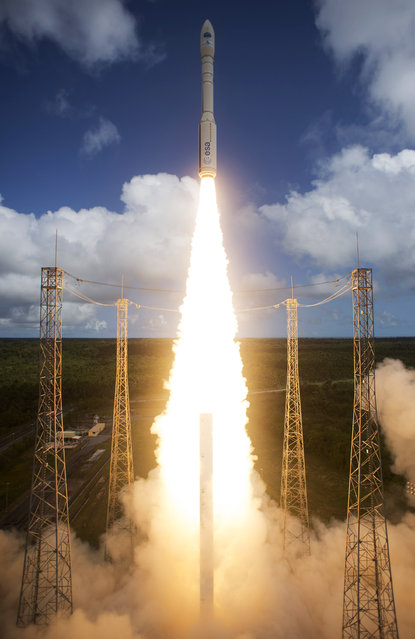 In this handout photo released by the European Space Agency (ESA),Vega VV04 carrying ESA's experimental spaceplane, IXV, during liftoff from Europe's Spaceport in Kourou on February 11, 2015 Kourou, French Guiana.  This IXV mission will test cutting-edge system and technology aspects to provide Europe with an independent reentry capability, and a building block for reusable space transportation systems. (Photo by Stephane Corvaja/ESA via Getty Images)