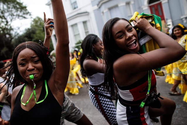 Revellers dance on the final day of the Notting Hill Carnival on August 27, 2018 in London, England. The Notting Hill Carnival, which has taken place annually since 1964, is expected to attract around a million people over the bank holiday weekend. The two-day event, started by members of the Afro-Caribbean community, sees costumed performers take to the streets in a parade and dozens of sound systems set up around the Notting Hill streets. (Photo by Jack Taylor/Getty Images)