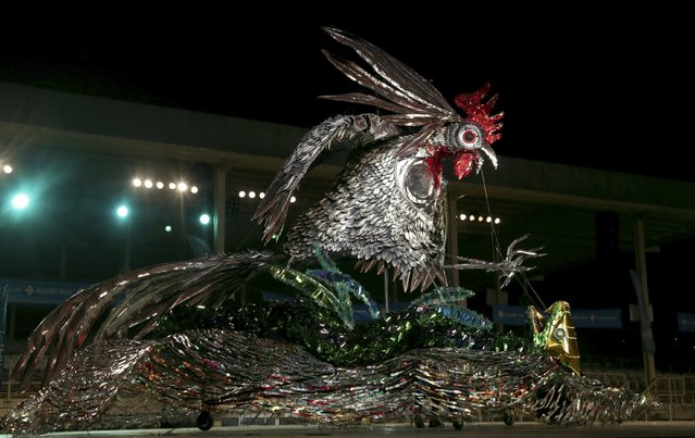 "Roland St George portrays ""Ahtwaje"", a depiction of a gamecock fighting a snake, which won him the King of Carnival title at the finals of the Kings and Queens show organised by the National Carnival Commission at the Queen's Park Savannah in Port-of-Spain, February 13, 2015. (Photo by Andrea De Silva/Reuters)"