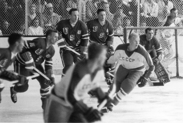 American professional hockey player John Mayasich (third from left), defenseman for Team USA, on the ice during the final round of men's ice hockey with the Soviet Team at the 1960 Winter Olympics in Blyth Arena at the Squaw Valley Ski Resort, Olympic Valley, California, February 27, 1960. American professional hockey player Jack McCartan (right), goalie for Team USA, guards the goal post. The American team scored a 3-2 victory over the Soviet Team and eventually won the gold medal. (Photo by Bruce Bennett Studios/Getty Images)