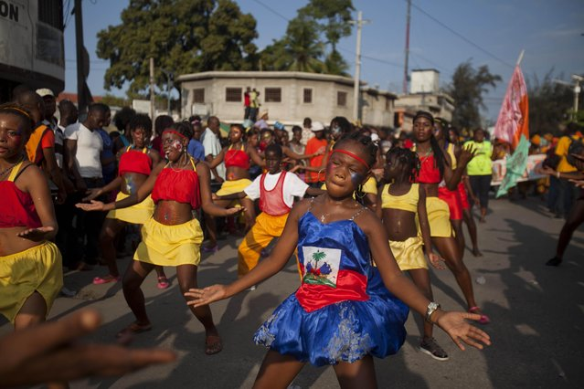 Dancers perform in a street parade, kicking off Carnival celebrations in Port-au-Prince, Haiti, Sunday, February 15, 2015. (Photo by Dieu Nalio Chery/AP Photo)