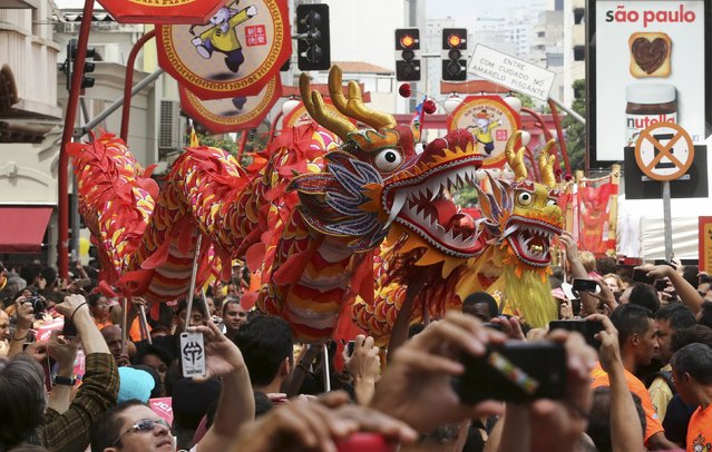 Performers present a dragon dance during Chinese Lunar New Year celebrations in Sao Paulo February 21, 2015. (Photo by Paulo Whitaker/Reuters)