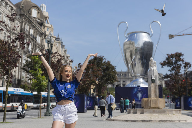 An Chelsea supporter takes pictures next to the giant inflatable replica of the UEFA Champions League trophy placed at Aliados Avenue in Porto, Portugal, 27th May 2021. Porto hosts the UEFA Champions League final between Manchester City and Chelsea in 29th May 2021. (Photo by Jose Coelho/EPA/EFE)