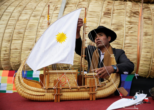 """An Aymara man arranges a replica of the totora reeds """"Viracocha III"""", a boat made only from the reed, as it is being prepared to cross the Pacific from Chile to Australia on an expected six-month journey, in La Paz, Bolivia December 15, 2016. (Photo by David Mercado/Reuters)"""