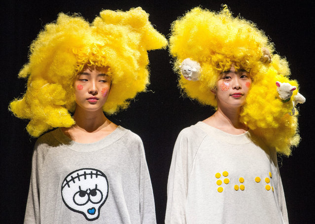 Models present a creation by Japanese designer Takafumi Tsuruta for his label Tenbo during the Mercedes-Benz Fashion Week in Tokyo, Japan, 18 March 2015. (Photo by Christopher Jue/EPA)