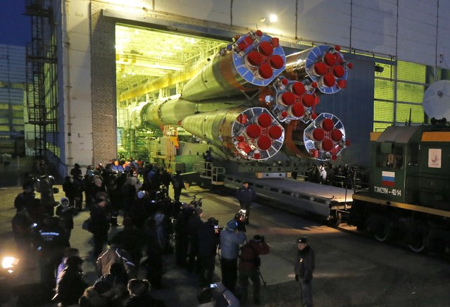 Russia's Soyuz-FG booster rocket with the space capsule Soyuz TMA-16M that will carry a new crew to the International Space Station (ISS) is transported from the hangar to the launch pad in Russian leased Baikonur cosmodrome, Kazakhstan, Wednesday, March 25, 2015. The new Soyuz mission is scheduled for Saturday, March 28. (Photo by Dmitry Lovetsky/AP Photo)