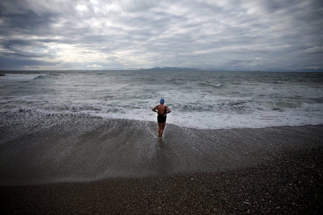 An Orthodox faithful braves the cold waters during Epiphany day celebrations in the southern suburb of Faliro in Athens, Greece January 6, 2017. (Photo by Alkis Konstantinidis/Reuters)