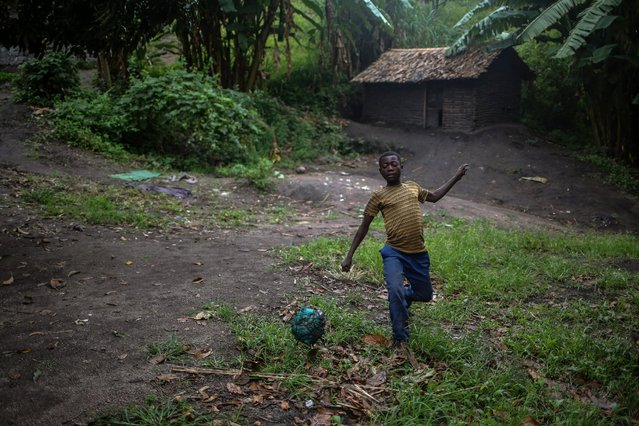 A boy plays football, at Kagorwa Pygmy camp on Idjwi island in the Democratic Republic of Congo, November 22, 2016. (Photo by Therese Di Campo/Reuters)