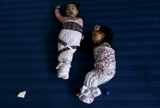 Sikh twins sleep during the Baisakhi festival at Panja Sahib shrine in Hassan Abdel April 13, 2015. (Photo by Caren Firouz/Reuters)