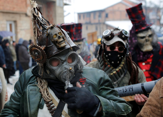 Revelers participate in a parade on the streets during a carnival to mark the annual Orthodox St. Vasilij Day in the village of Vevcani, south of the Macedonian capital of Skopje, January 13, 2017. (Photo by Ognen Teofilovski/Reuters)