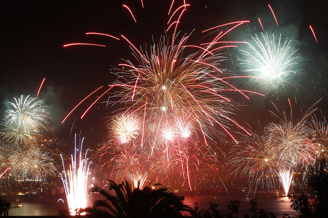 Fireworks explode during a pyrotechnics show to celebrate the New Year in the coastal city of Valparaiso, about 121 km (75 miles) northwest of Santiago, January 1, 2014. (Photo by Eliseo Fernandez/Reuters)