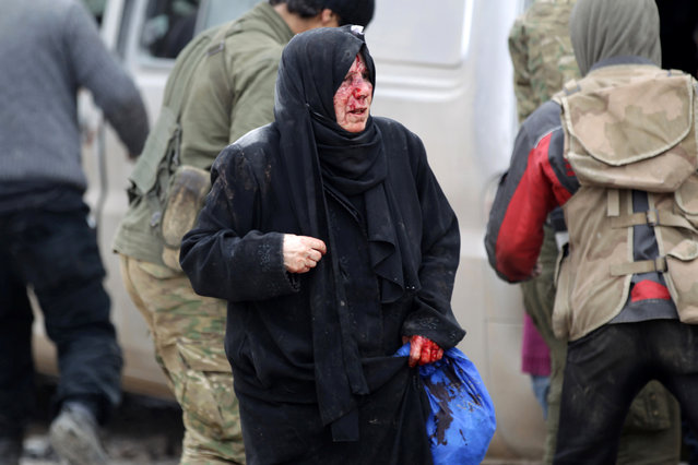 An injured woman reacts after a car bomb explosion in Jub al Barazi east of the northern Syrian town of al-Bab, Syria January 15, 2017. (Photo by Khalil Ashawi/Reuters)