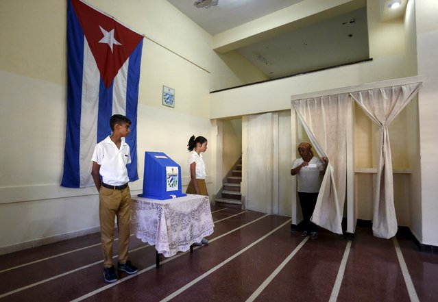 A woman walks out of a voting booth to cast her vote at a polling station at a school in Havana April 19, 2015. (Photo by Reuters/Stringer)