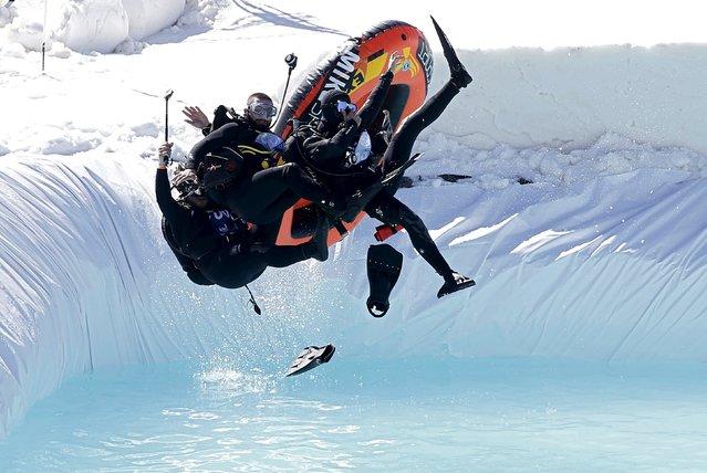 People participate in the Red Bull Jump & Freeze Lebanon at Mzaar Kfardebian Ski Resort in mount Lebanon, February 28, 2016. (Photo by Jamal Saidi/Reuters)