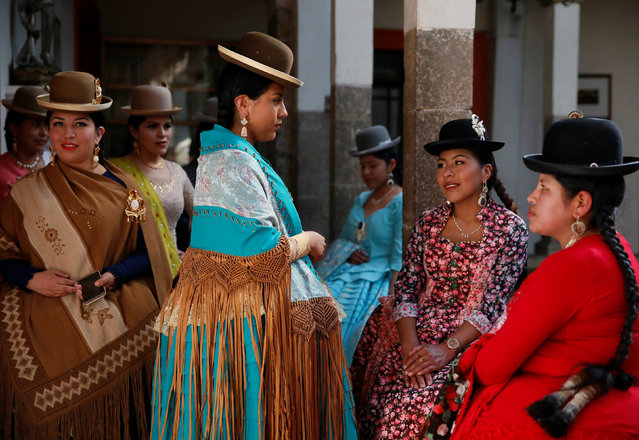 Cholitas (Andean women) attend a practice session of Rosario Aguilar fashion model school in La Paz, Bolivia, February 23, 2019. (Photo by David Mercado/Reuters)
