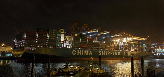 "The world's biggest container vessel ""CSCL Globe"" is seen in the harbor of Hamburg, in this January 13, 2015 file photo. More than half of China's exporters expect a trade slowdown to last at least six months as production costs climb and European demand weakens, according to a Reuters survey at the country's biggest trade fair. (Photo by Morris Mac Matzen/Reuters)"