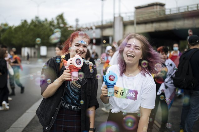 Participants use bubbles guns during the annual Gay Pride march in Paris, Saturday, June 26, 2021. (Photo by Lewis Joly/AP Photo)