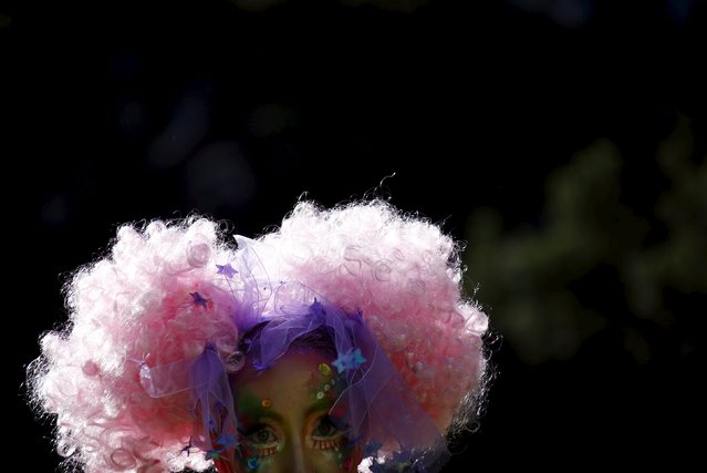 A performer dressed in costume prepares to participate in the Gay and Lesbian Mardi Gras parade in Sydney, Australia, March 5, 2016. (Photo by David Gray/Reuters)