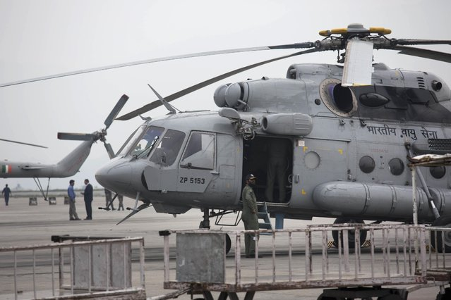 An Indian army helicopter is parked on the tarmac of the Kathmandu international airport the day after a massive earthquake devastated the region, in Kathmandu, Nepal, Sunday, April 26, 2015. (Photo by Bernat Armangue/AP Photo)