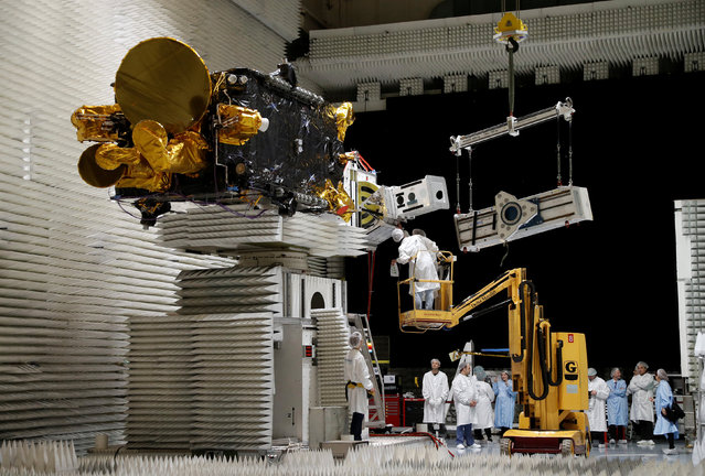Technicians work on the Korean satellite Koreasat 5A in the clean room facilities of the Thales Alenia Space plant in Cannes, France, February 3, 2017. (Photo by Eric Gaillard/Reuters)
