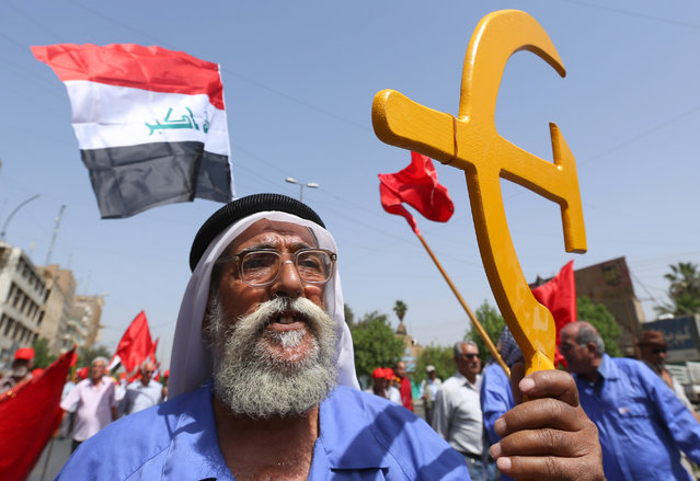 Supporters of the Iraqi Communist Party take part in a May Day celebration in Baghdad, Iraq, Friday, May 1, 2015. (Photo by Hadi Mizban/AP Photo)