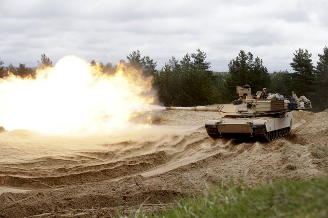 "U.S. soldiers of the 2nd Battalion, 7th Infantry Regiment, ""Cottonbalers"", who are deployed in Latvia, take part in a training exercise with M1A2 ""Abrams"" tank in Adazi military base, Latvia, May 7, 2015. (Photo by Ints Kalnins/Reuters)"