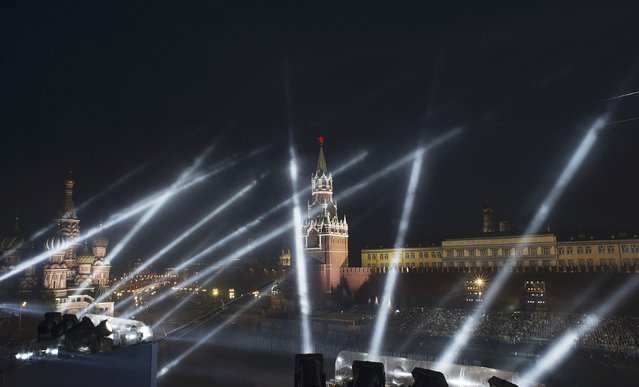 A view of St. Basil's Cathedral (L), the Kremlin's Spasskaya (Saviour) Tower and Red Square during a festive concert marking the 70th anniversary of the end of World War Two in Europe, in Moscow, Russia, May 9, 2015. (Photo by Reuters/Host Photo Agency/RIA Novosti)