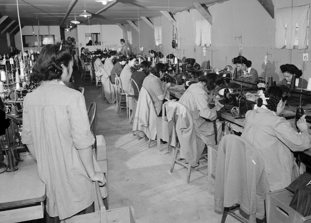 Sumiko Shigematsu supervises a row of women seated at sewing machines at the Manzanar War Relocation Center in California, in this 1943 handout photo. (Photo by Courtesy Ansel Adams/Library of Congress, Prints and Photographs Division/Reuters)
