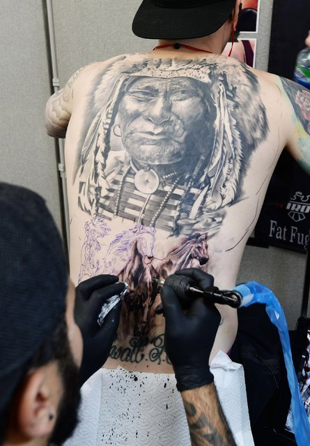 Tattoo artists Adem Senturk works at the 2017 Tattoo Collective event at the Old Truman Brewery in London, England on February 17, 2017. (Photo by PA Wire)
