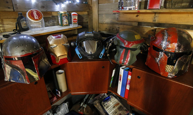 In this photo taken photo taken April 8, 2015, helmets for different costumes sit on a shelf inside Clay Hielscher's home in Overbrook, Kan.. (Photo by Chris Neal/AP Photo/The Topeka Capital-Journal)