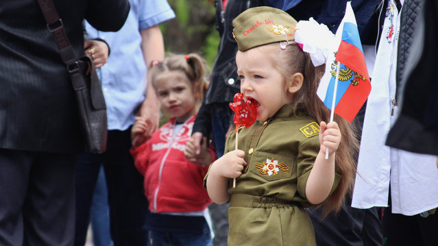 A young Crimean girl wears military-type clothes during a Victory Day celebration in Sevastopol on May 9, 2018. (Photo by Oleksandra Surgan/Radio Free Europe/Radio Liberty)