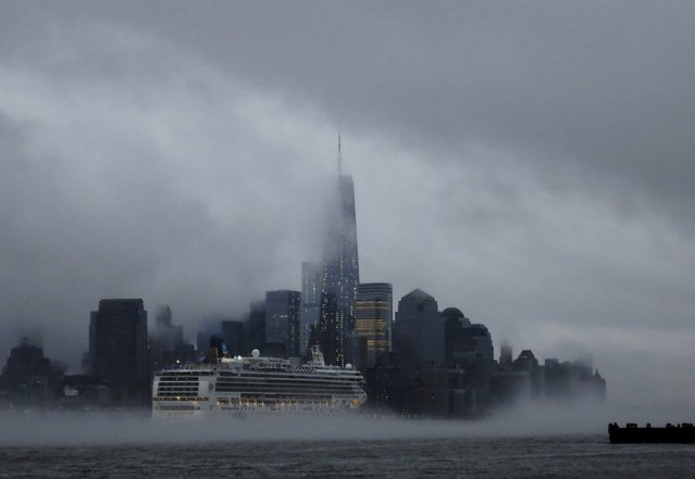 A cruise ship makes its way past New York's Lower Manhattan and One World Trade Center as steam rises from the Hudson River as seen from Hoboken, New Jersey, United States in this January 11, 2014 file photo. (Photo by Gary Hershorn/Reuters)