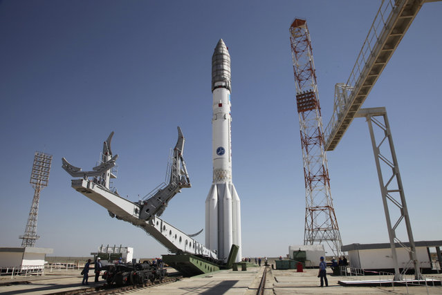 In this photo taken Tuesday, May 13, 2014, a Proton-M rocket is installed at Baikonur launch pad in Kazakhstan. A Russian rocket, Proton-M, carrying a Mexican satellite malfunctioned Saturday shortly after its launch, the latest mishap to hit Russia's troubled space industry, whose Soviet-era glory has been tarnished by a series of launch failures. (Photo by Roscosmos via AP Photo)