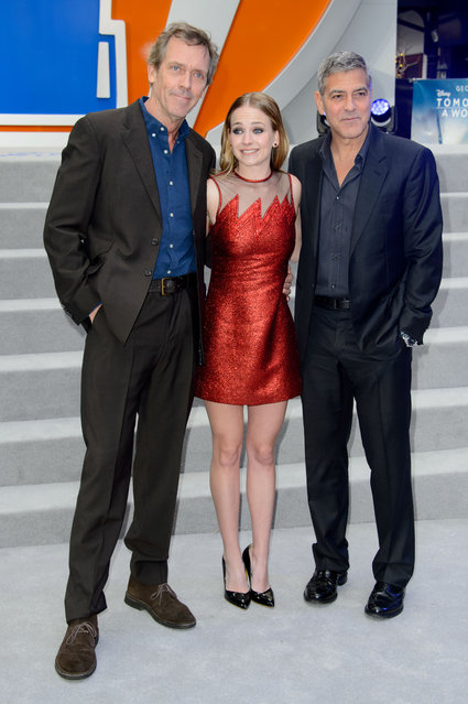 British actor, Hugh Laurie, left, U.S actress, Britt Robertson, centre and U.S actor George Clooney pose for photographers upon arrival for the European premiere of Tomorrowland: A World Beyond at a central London cinema, Sunday, May 17, 2015. (Photo by Jonathan Short/Invision/AP Photo)