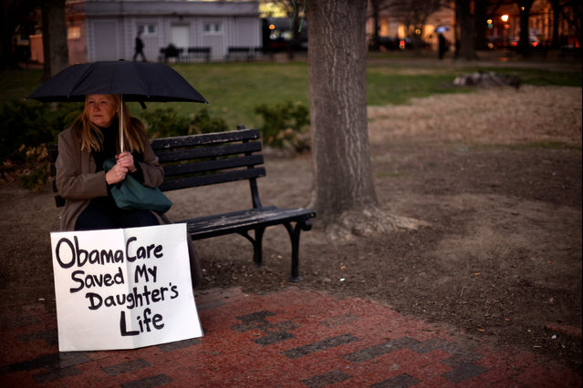 Beverly Hopper of Pine Grove, California, attends a protest rally against U.S. President Donald Trump in the rain outside the White House in Washington February 28, 2017. (Photo by James Lawler Duggan/Reuters)