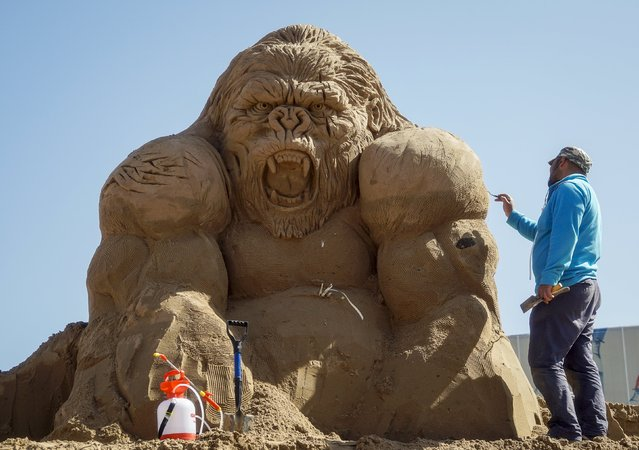 "Ruslan Arslanbayev of Russia works on his creation during the Sand Sculpture Festival ""Sand Fantasy"" in Almaty, Kazakhstan, April 15, 2016. (Photo by Shamil Zhumatov/Reuters)"