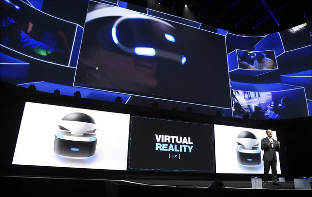 Andrew House, bottom right, president and global CEO of Sony Computer Entertainment Inc., talks about the Sony Morpheus virtual reality headset at the Sony Playstation at E3 2015 news conference at the Los Angeles Sports Arena on Monday, June 15, 2015, in Los Angeles. (Photo by Chris Pizzello/Invision/AP)